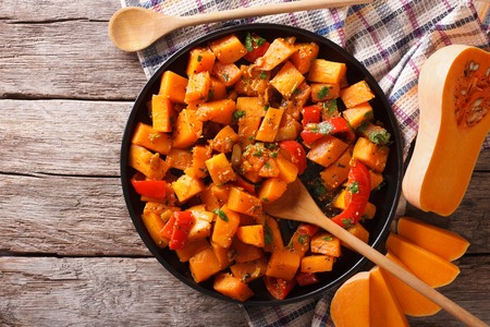 Vegetarian food: pumpkin curry on a plate. horizontal top view 스톡 콘텐츠