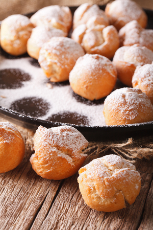 zeppole: Homemade Freshly fried donuts Castagnole closeup. vertical Stock Photo