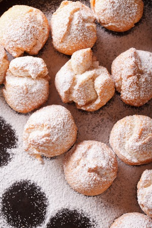 zeppole: Italian street food: fried Castagnole close-up. vertical view from above Stock Photo