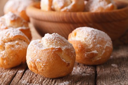 zeppole: Festive Italian donuts Castagnole close up in a bowl on the table. Horizontal