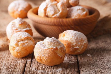 zeppole: Delicious Italian Castagnole with powdered sugar macro on the table. horizontal