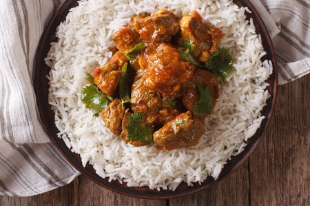 Madras: Traditional beef madras with basmati rice close-up on a plate. horizontal view from above Stock Photo
