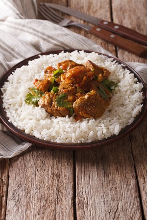 Madras: Beef Madras with basmati rice close-up on a plate. Vertical Stock Photo