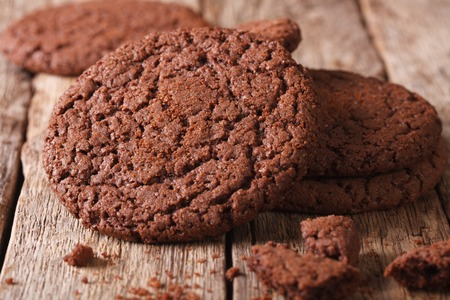 sweet sugar snap: Fresh chocolate cookies with cracks macro on the table. horizontal, rustic