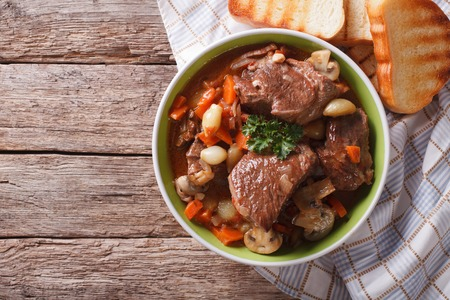 braised mushrooms: Homemade Beef Bourguignon in a bowl on the table. horizontal view from above Stock Photo