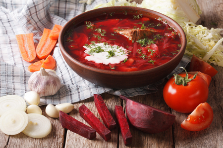 Ukrainian borsch soup and ingredients on the table close-up. horizontal Banco de Imagens