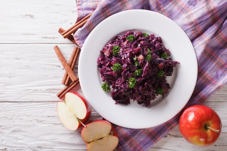 red braised: braised red cabbage with ingredients on the table. horizontal view from above