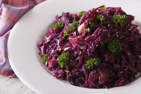 red braised: Delicious braised red cabbage close-up on a plate. horizontal Stock Photo