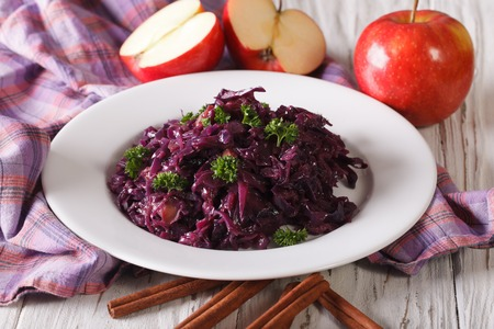 red braised: Traditional braised red cabbage with apples close up on a plate. horizontal Stock Photo