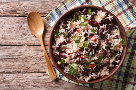 pinto beans: Rice with red beans and vegetables in a bowl on the table. horizontal view from above