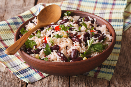 pinto beans: Healthy food: rice with red beans in a bowl close-up on the table. horizontal Stock Photo