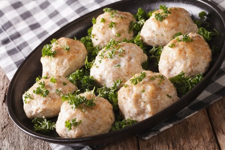 dietary: Dietary chicken meatballs with parsley close-up on a plate. horizontal