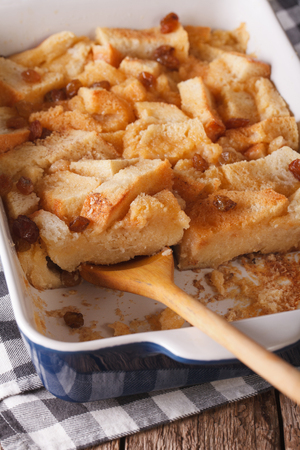 english food: English food: bread pudding with raisins close up in baking dish. vertical Stock Photo