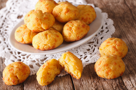 half ball: French pastries gougere with cheese on a plate on the table. Horizontal