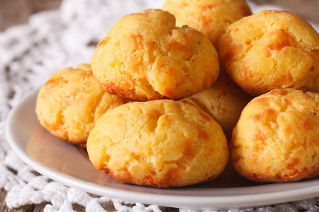 choux bun: French snack gougere buns with cheese on a plate macro. horizontal Stock Photo