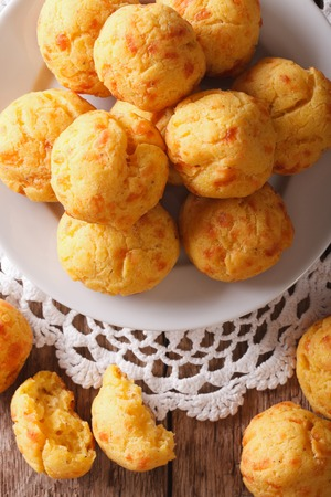 choux bun: Freshly baked cheese snack buns close-up on a plate. vertical view from above Stock Photo