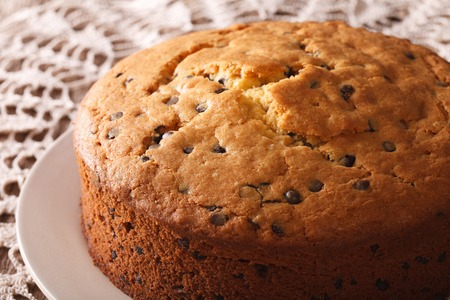 morsels: Homemade sponge cake with chocolate chips close-up on the table. horizontal Stock Photo