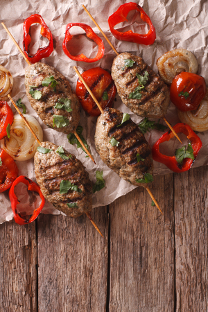 turkish kebab: Turkish kebab with grilled vegetables on the table. vertical view from above