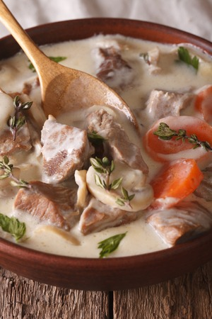 convivial: Blanquette de veau close up in a bowl on the table. Vertical