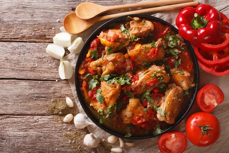 Chakhokhbili chicken stew with vegetables on the table. horizontal view from above