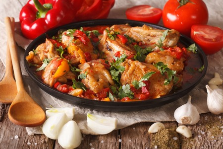 Georgian cuisine: Chakhokhbili chicken stew with vegetables on the table. close-up. Horizontal Banco de Imagens