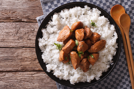 philippine: Philippine Adobo chicken with rice on a plate horizontal view from above