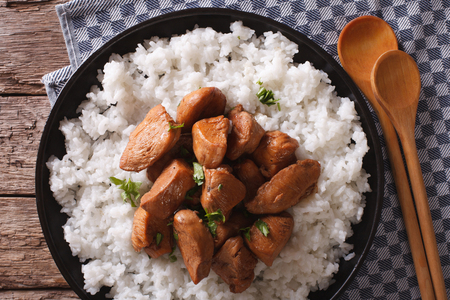 philippine: Philippine cuisine: Adobo with rice close-up on a plate. horizontal view from above