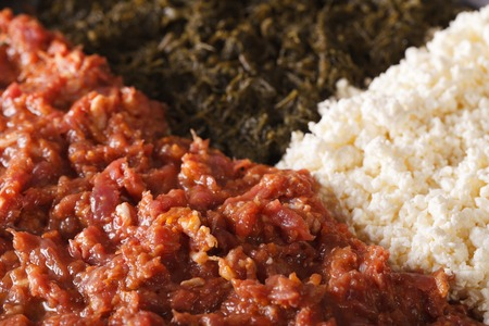 clarified: Ethiopian cuisine: kitfo with herbs and cheese a macro. horizontal background Stock Photo