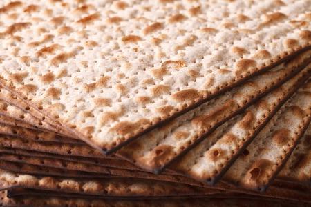 pesah: Pile of Jewish Matza Flatbread texture close-up, horizontal background