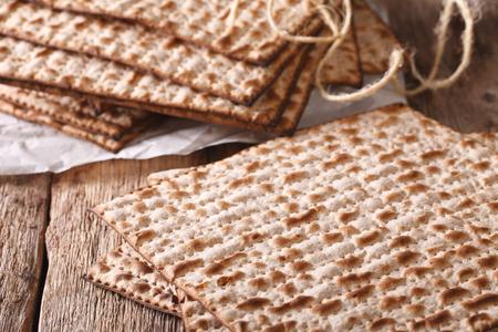 matzah: Jewish kosher matzah macro on a wooden table. horizontal Stock Photo