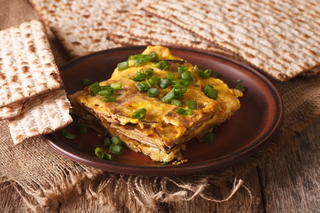 matzoh: Jewish omelette: matzah brei with green onions close-up on a plate. horizontal