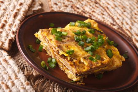 jewish cuisine: Jewish cuisine: matzah brei with green onions close-up on a plate. horizontal Stock Photo