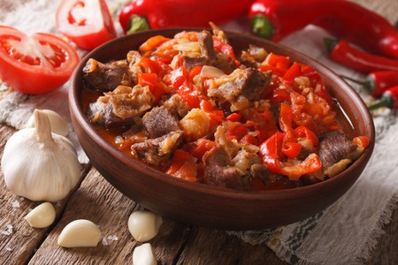 oriental cuisine: Oriental cuisine: lamb slow stewed with vegetables in a bowl close-up on the table. horizontal Stock Photo