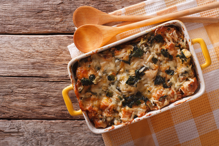 casserole with spinach and cheese close up in a dish for baking. horizontal view from above