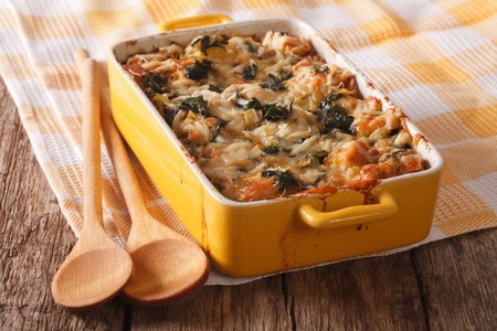 strata: Strata casserole with spinach close up in baking dish. Horizontal