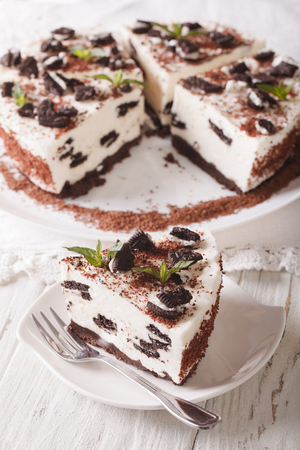 custard slices: Delicious cheesecake with chocolate cookies closeup on a plate. vertical