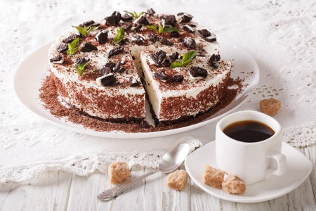 rebanada de pastel: Cheesecake dessert with chocolate and coffee on the table. horizontal Foto de archivo