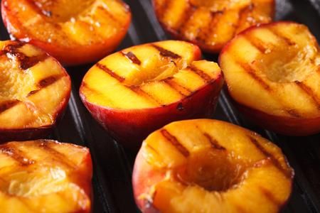 Fresh peaches on grill macro. Horizontal background