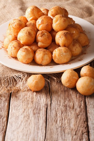 gulab: Mediterranean cuisine: fried donuts with honey and cinnamon close-up on the table. vertical Stock Photo