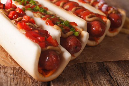 A variety of freshly made hot dogs macro on the table. Horizontal