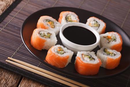 philadelphia roll: Uramaki. Philadelphia roll classic. Salmon, Philadelphia cheese, cucumber, avocado, tobiko. Japanese sushi
