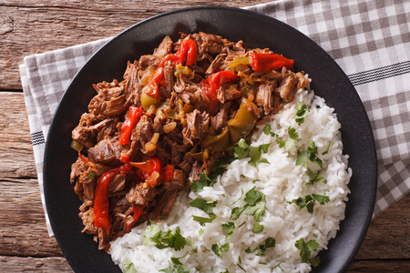 vieja: Cuban cuisine: ropa vieja meat with rice garnish on a plate  close-up. Horizontal view from above Stock Photo