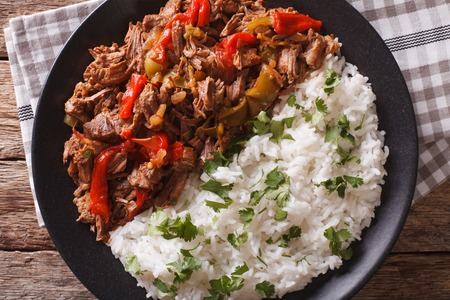 vieja: Latin American cuisine: ropa vieja with rice  close-up on a plate. Horizontal view from above
