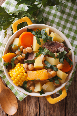 american cuisine: South American cuisine: thick soup Pouchero close-up in a pot on the table. vertical view from above Stock Photo
