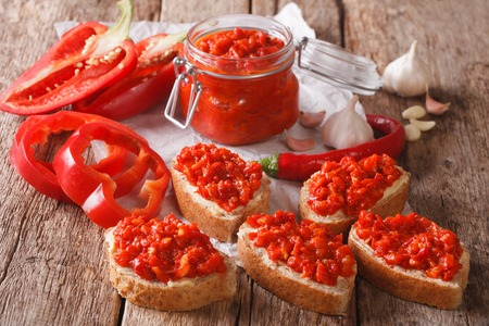 traditional Balkan ajvar from peppers with garlic close-up on the table. horizontal