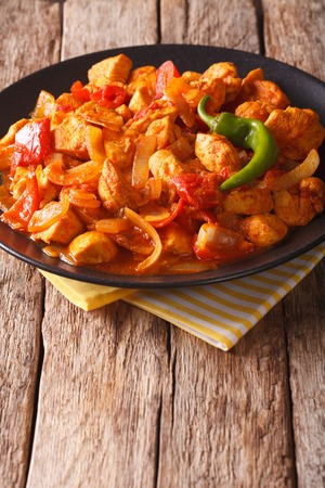 dietetic: Chicken jalfrezi Indian culture fried spicy curry chilli sauce meat and vegetables healthy dietetic food. Vertical Stock Photo