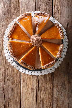 recipe decorated: Tasty Hungarian Dobosh torte with caramel decoration close-up on a plate. Vertical view from above Stock Photo