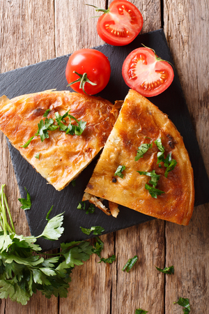 Homemade sliced burek stuffed with meat close-up on a table. vertical view from above Stock Photo