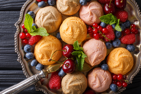 stuffing: Multicolored biscuits with raspberries, strawberries, cherries and currants close-up on the table. horizontal view from above Stock Photo