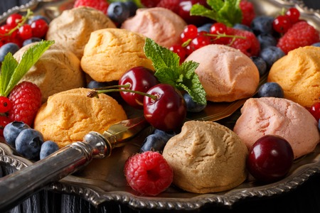 stuffing: Beautiful food background: cookies and fresh berries close-up in a dish. horizontal